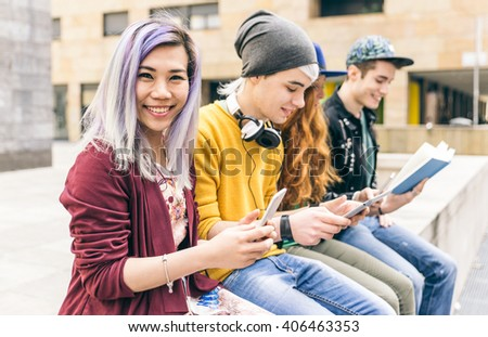 Group of students studying together in an urban area - stock photo