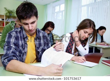 group of students takes the exercise  in classroom - stock photo