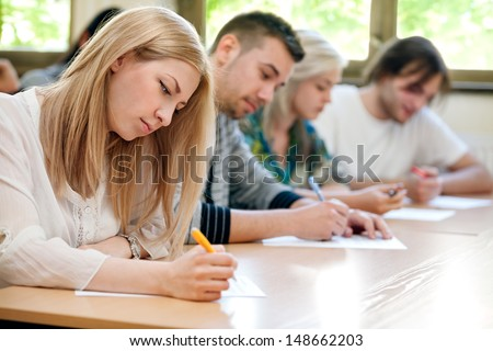 group of students takes the test in class - stock photo