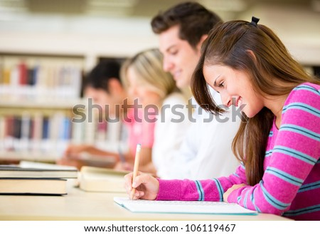 Group of students taking a test at the university - stock photo