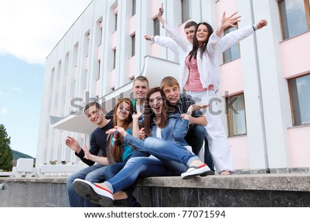 Group of students to complete academic year - stock photo