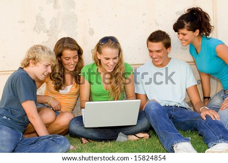 group of students with laptop - stock photo