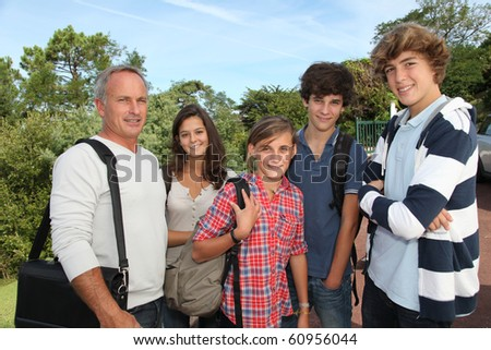 Group of students with teacher - stock photo
