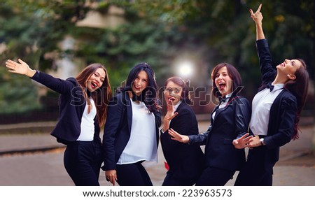 group of stylish happy women on evening street - stock photo