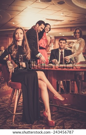 Group of stylish people playing in a casino - stock photo