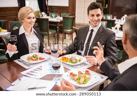 Group of successful business people celebrating a great deal agreement. - stock photo