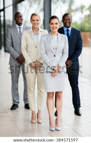 group of successful business people in modern office - stock photo