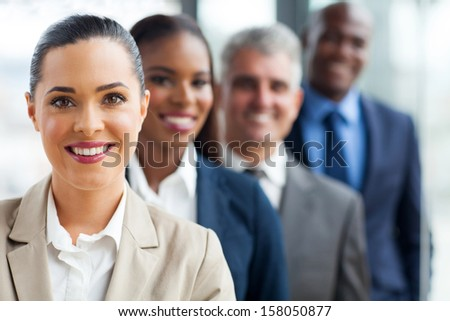 group of successful business team standing in a row - stock photo