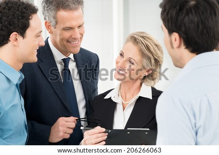 Group Of Successful Businesspeople Standing Together - stock photo