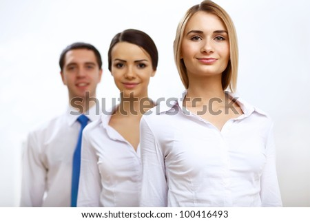 Group of successful young business persons together - stock photo