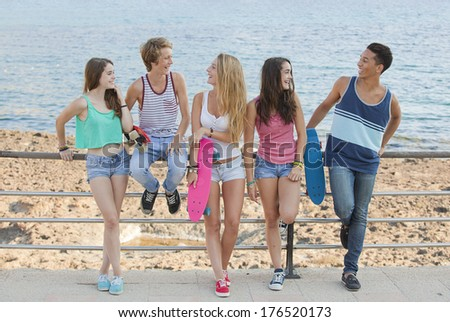 group of summer friends chatting - stock photo