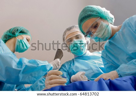 Group of surgeons - stock photo