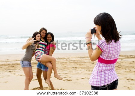 group of teen friends taking photos of each other - stock photo