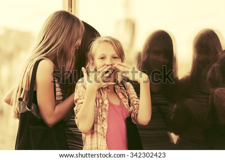 Group of teen girls looking through the mall window  - stock photo