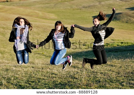 group of teen people woman  have fun outdoor with blue sky in background - stock photo