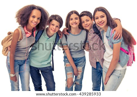 Group of teenage boys and girls with school backpacks is looking at camera and smiling, isolated on white - stock photo