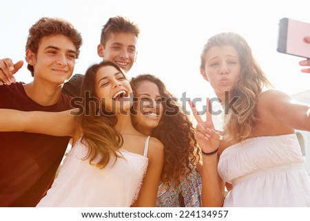Group Of Teenage Friends Dancing And Taking Selfie - stock photo