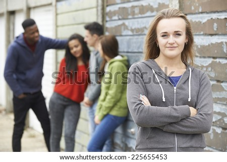 Group Of Teenage Friends Hanging Out In Urban Setting - stock photo