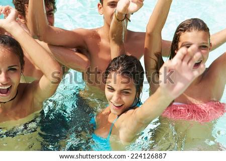 Group Of Teenage Friends Having Fun In Swimming Pool - stock photo