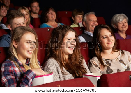 Group Of Teenage Girls Watching Film In Cinema - stock photo