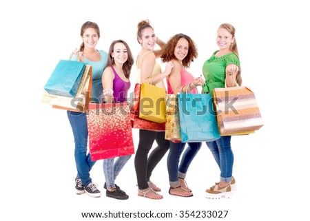 group of teenage girls with shopping bags isolated in white background - stock photo