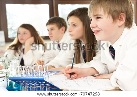 Group Of Teenage Students In Science Class - stock photo