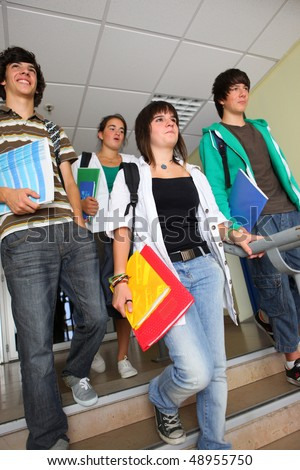 Group of teenagers getting off school - stock photo