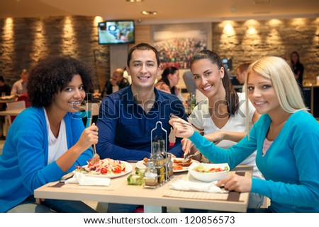 Group of teenagers students on lunch - stock photo