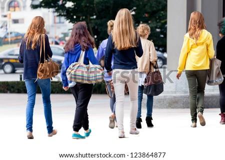 Group of teenagers. Urban scene. - stock photo
