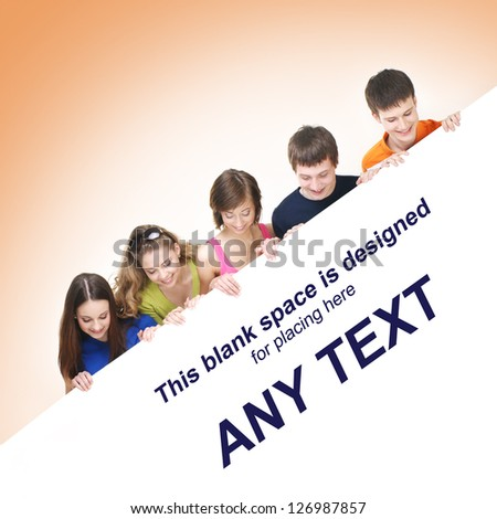 Group of teenagers with a giant, blank, white billboard over orange background - stock photo