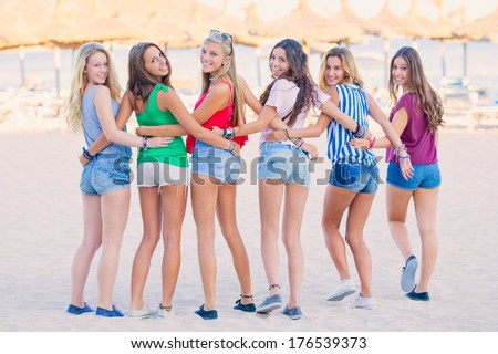 group of teens at beach on summer vacation - stock photo