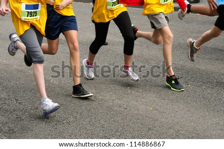Group of teens at the start of a race - stock photo