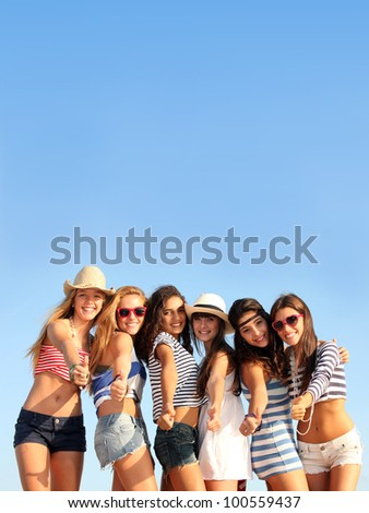 group of teens on beach summer vacation or spring break - stock photo