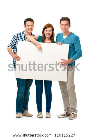 Group of teens standing together and holding a blank board - stock photo