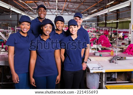 group of textile workers in production area - stock photo