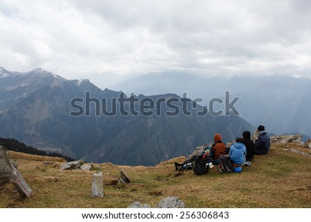 group of the tourist on the top of chanderkhani pass in himalayan mountains - stock photo