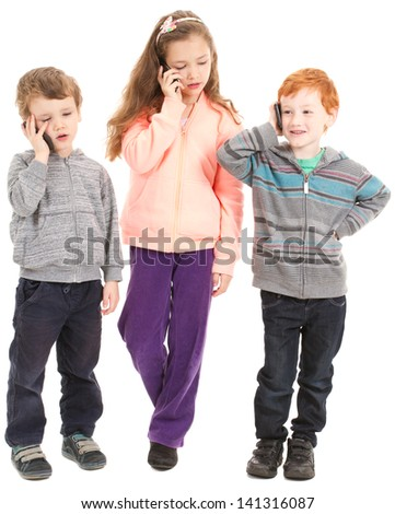 Group of three children talking on kids mobile phones. Isolated on white. - stock photo