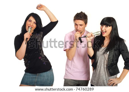 Group of three friends singing with microphones isolated on white background - stock photo
