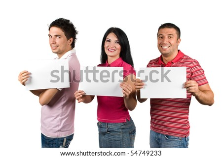 Group of three happy friends with toothy smile standing in a line and showing blank pages isolated on white background - stock photo