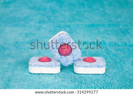 Group of three modern chemical tablets for dishwasher - stock photo