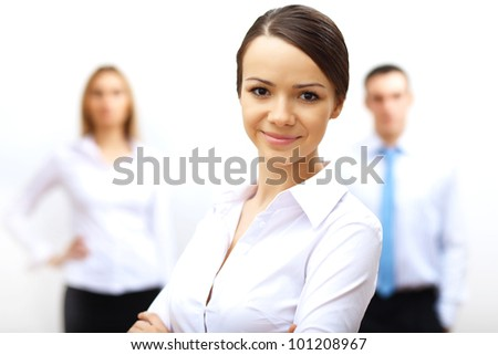 Group of three successful young business persons together - stock photo