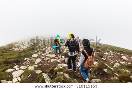 group of tourists coming down from Goverly - stock photo