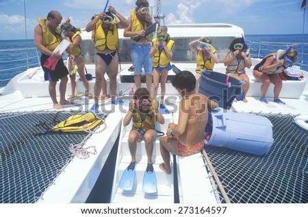 Group of tourists on  Catamaran tour boat preparing to Snorkel, Key West, FL - stock photo