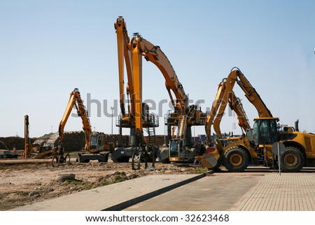 Group of tractors and other specialized machinery - stock photo