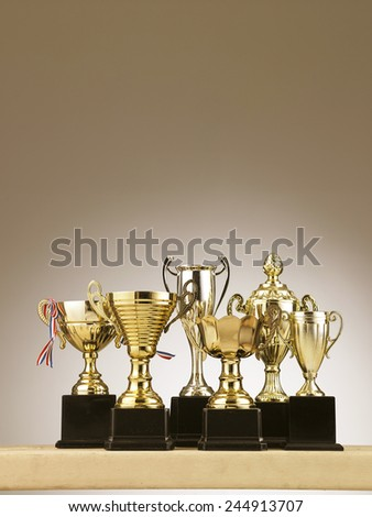 group of trophies on the table - stock photo