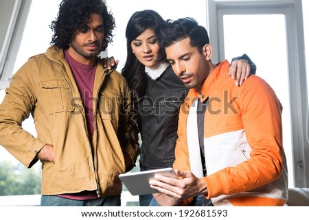 group of  university friends using Pc tablet and hanging out together - stock photo