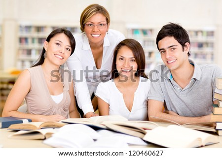Group of university students at the library - stock photo