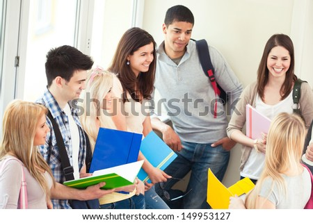 Group of university students talking during the break between classes. - stock photo