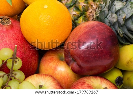 Group of various ripe juicy fruits on marketplace - stock photo