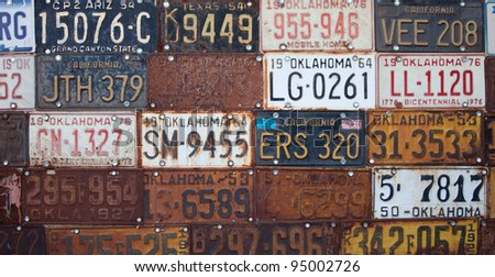 Group of vintage old American license plates - stock photo